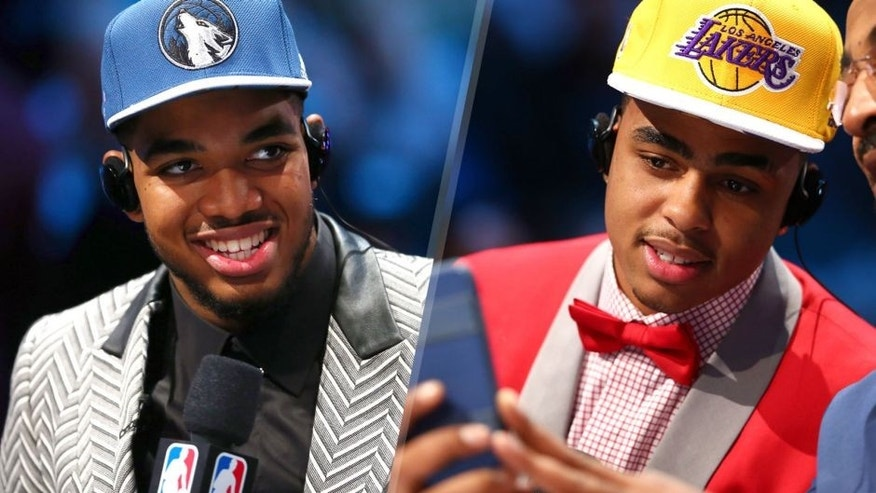 NEW YORK, NY - JUNE 25: Karl-Anthony Towns speaks to the media after being drafted first overall by the Minnesota Timberwolves in the First Round of the 2015 NBA Draft at the Barclays Center on June 25, 2015 in the Brooklyn borough of New York City. NOTE TO USER: User expressly acknowledges and agrees that, by downloading and or using this photograph, User is consenting to the terms and conditions of the Getty Images License Agreement. (Photo by Elsa/Getty Images) NEW YORK, NY - JUNE 25: D'Angelo Russell speaks to the media after being drafted second overall by the Los Angeles Lakers in the First Round of the 2015 NBA Draft at the Barclays Center on June 25, 2015 in the Brooklyn borough of New York City. NOTE TO USER: User expressly acknowledges and agrees that, by downloading and or using this photograph, User is consenting to the terms and conditions of the Getty Images License Agreement. (Photo by Elsa/Getty Images)