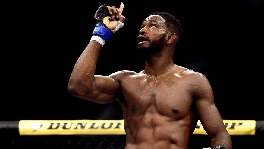 "RIO DE JANEIRO, BRAZIL - OCTOBER 25: Neil Magny of the United States celebrates after his TKO victory over William ""Patolino"" Macario in their welterweight bout during the UFC 179 event at Maracanazinho on October 25, 2014 in Rio de Janeiro, Brazil. (Photo by Buda Mendes/Getty Images)"