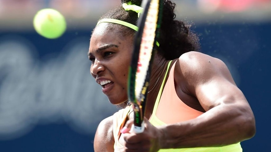 Serena Williams hits a return to Flavia Pennetta, of Italy, during second round play at the Rogers Cup tennis tournament in Toronto, Tuesday, Aug. 11, 2015. (Frank Gunn/The Canadian Press via AP)