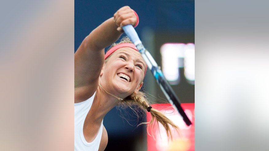 Victoria Azarenka, of Belarus, serves to Elina Svitolina, of Ukraine, at the Rogers Cup tennis tournament in Toronto, Tuesday Aug. 11, 2015.  (Frank Gunn/The Canadian Press via AP)