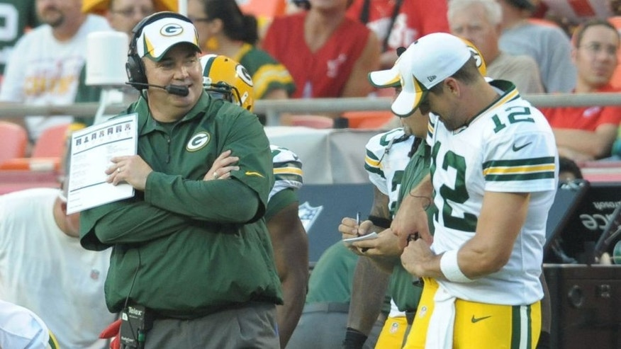 <p>Aug 29, 2013; Kansas City, MO, USA; Green Bay Packers head coach Mike McCarthy and quarterback Aaron Rodgers (12) talk on the sidelines during the first half of the game against the Kansas City Chiefs at Arrowhead Stadium. Mandatory Credit: Denny Medley-USA TODAY Sports</p>