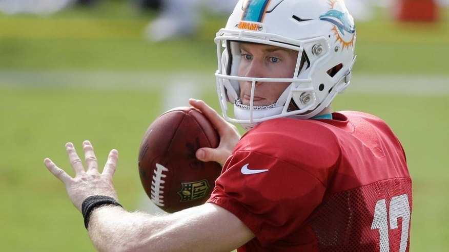 Miami Dolphins quarterback Ryan Tannehill drops back to pass during an NFL football training camp practice, Tuesday, Aug. 11, 2015 in Davie, Fla. (AP Photo/Wilfredo Lee)