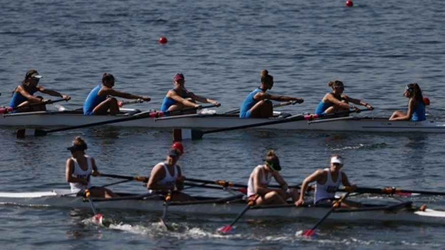 Aug. 4, 2015: Teams of rowers from Italy, top, and the U.S., bottom, practice for the 2015 World Rowing Junior Championships on  Rodrigo de Freitas lake in Rio de Janeiro, Brazil. (AP Photo/Silvia Izquierdo)