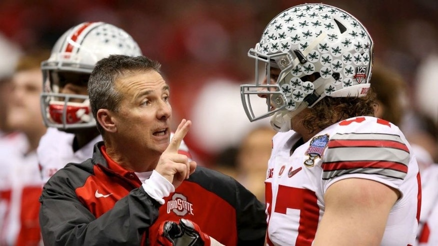 <p>Ohio State Buckeyes head coach Urban Meyer talks with Ohio State Buckeyes defensive lineman Joey Bosa (97) before in the third quarter of the 2015 Sugar Bowl at Mercedes-Benz Superdome.</p>