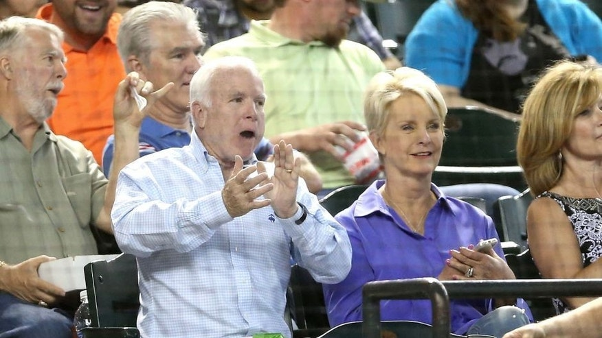 PHOENIX, AZ - MAY 17: U.S. Senator John McCain (R-AZ) and wife Cindy attend the MLB game between the Arizona Diamondbacks and the Los Angeles Dodgers at Chase Field on May 17, 2014 in Phoenix, Arizona. (Photo by Christian Petersen/Getty Images)