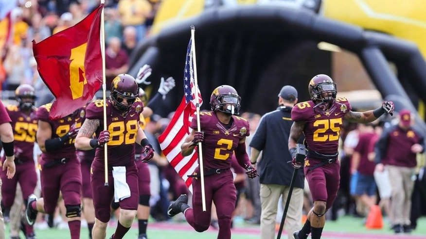 <p>Jan 1, 2015; Orlando, FL, USA; Minnesota Golden Gophers tight end Maxx Williams (88), defensive back Cedric Thompson (2), and wide receiver Devon Wright (25) lead their team out of the tunnel during the 2015 Citrus Bowl at Florida Citrus Bowl in Orlando, Florida. Missouri wins 33-17 over Minnesota. Mandatory Credit: Jim Dedmon-USA TODAY Sports</p>