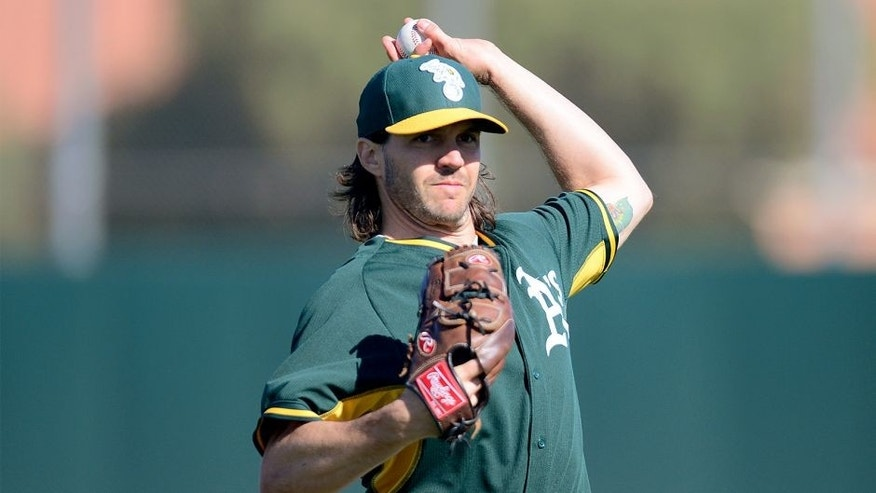 <p>Feb 25, 2015; Mesa, AZ, USA; Oakland Athletics pitcher Barry Zito (75) throws during a workout at Fitch Park. Mandatory Credit: Joe Camporeale-USA TODAY Sports</p>