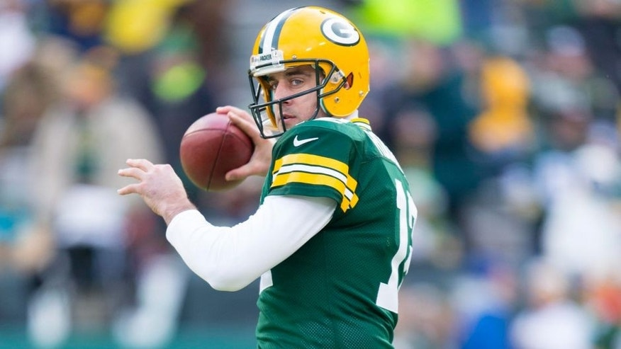<p>Dec 28, 2014; Green Bay, WI, USA; Green Bay Packers quarterback Aaron Rodgers (12) throws a pass during warmups prior to the game against the Detroit Lions at Lambeau Field. Mandatory Credit: Jeff Hanisch-USA TODAY Sports</p>