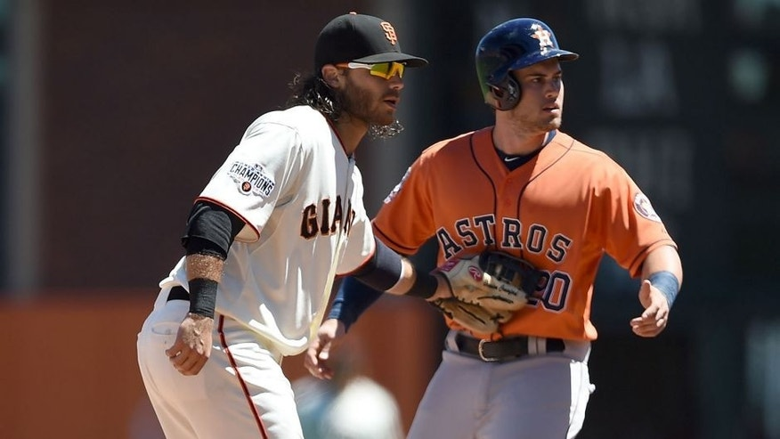 SAN FRANCISCO, CA - AUGUST 12: Brandon Crawford #35 of the San Francisco Giants tags out Preston Tucker #20 of the Houston Astros attempting to steal second base in the top of the six inning at AT&T Park on August 12, 2015 in San Francisco, California. (Photo by Thearon W. Henderson/Getty Images)
