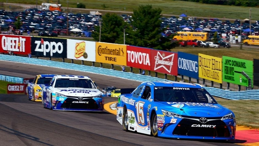 WATKINS GLEN, NY - AUGUST 09: Clint Bowyer, driver of the #15 Maxwell House Toyota, leads David Ragan, driver of the #55 Aaron's Dream Machine Online Version Toyota, ahead of a pack of cars during the NASCAR Sprint Cup Series Cheez-It 355 at the Glen at Watkins Glen International on August 9, 2015 in Watkins Glen, New York. (Photo by Robert Laberge/NASCAR via Getty Images)