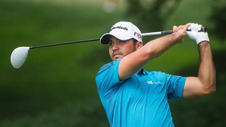 Jason Day, of Australia, watches his tee shot on the second hole, during the final round of the Bridgestone Invitational golf tournament, in Akron, Ohio, Sunday, Aug. 9, 2015. (AP Photo/Phil Long)