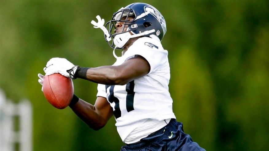 Jul 25, 2014; Renton, WA, USA; Seattle Seahawks free safety Dion Bailey (37) intercepts a pass during training camp practice at the Virginia Mason Athletic Center. Mandatory Credit: Joe Nicholson-USA TODAY Sports