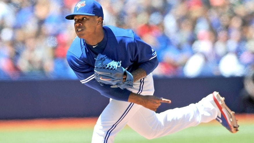 Jul 24, 2014; Toronto, Ontario, CAN; Toronto Blue Jays starting pitcher Marcus Stroman delivers a pitch during the Jays 8-0 win over Boston Red Sox at Rogers Centre. Mandatory Credit: Dan Hamilton-USA TODAY Sports