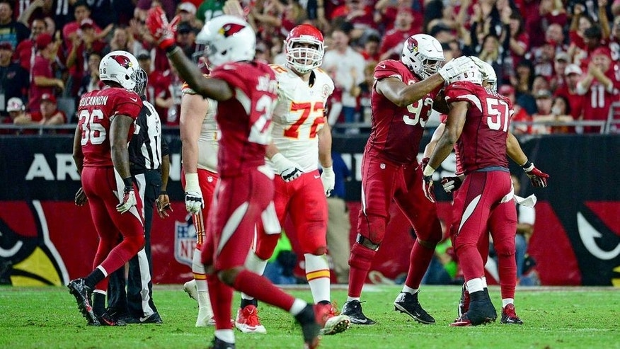 GLENDALE, AZ - DECEMBER 07: Defensive end Calais Campbell #93 of the Arizona Cardinals celebrates with outside linebacker Alex Okafor #57 after making a tackle in the second half during the NFL game against the Kansas City Chiefs at University of Phoenix Stadium on December 7, 2014 in Glendale, Arizona. (Photo by Jennifer Stewart/Getty Images)