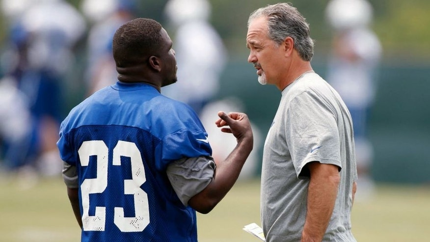 Jun 9, 2015; Indianapolis, IN, USA; Indianapolis Colts running back Frank Gore (23) talks to coach Chuck Pagano during minicamp at the Indiana Farm Bureau Football Center. Mandatory Credit: Brian Spurlock-USA TODAY Sports