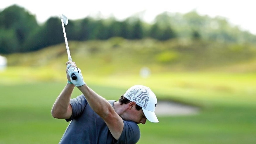 Rory McIlroy, of Northern Ireland, hits on the driving range before a practice round for the PGA Championship golf tournament Wednesday, Aug. 12, 2015, at Whistling Straits in Haven, Wis. (AP Photo/Chris Carlson)