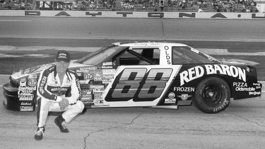 DAYTONA BEACH, FL - FEBRUARY 14: Buddy Baker driver of the #88 Red Baron Pizza Oldsmobile, poses in front of his car before the 1988 Daytona 500 at the Daytona International Speedway on February 14, 1988 in Daytona Beach, Florida. (Photo by ISC Archives via Getty Images)