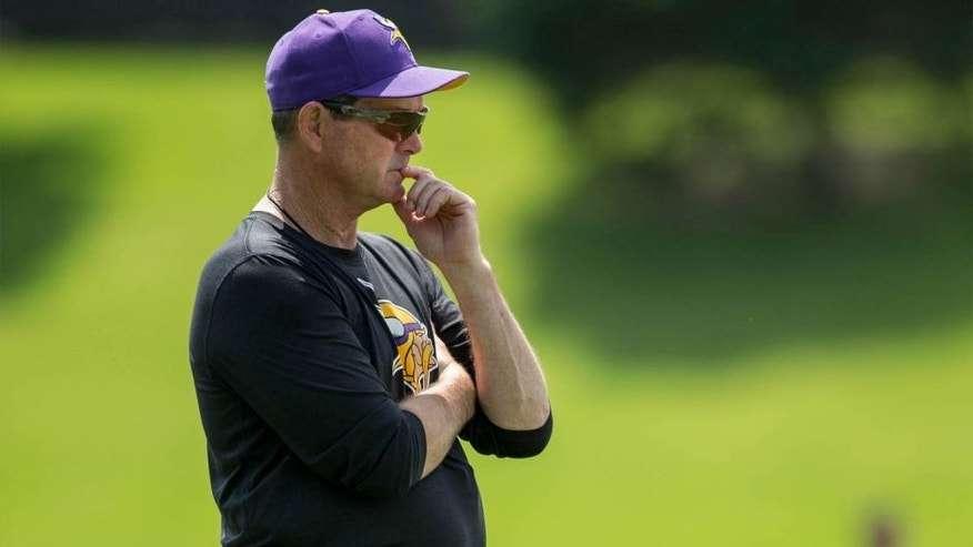 Jun 17, 2014; Eden Prairie, MN, USA; Minnesota Vikings head coach Mike Zimmer watches practice at Winter Park.