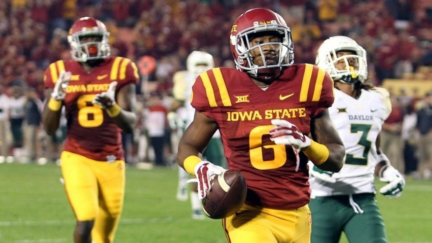 Sep 27, 2014; Ames, IA, USA; Iowa State Cyclones wide receiver D'Vario Montgomery (8) scores a late touchdown against the Baylor Bears at Jack Trice Stadium. Baylor beat the Cyclones 49-28. Mandatory Credit: Reese Strickland-USA TODAY Sports