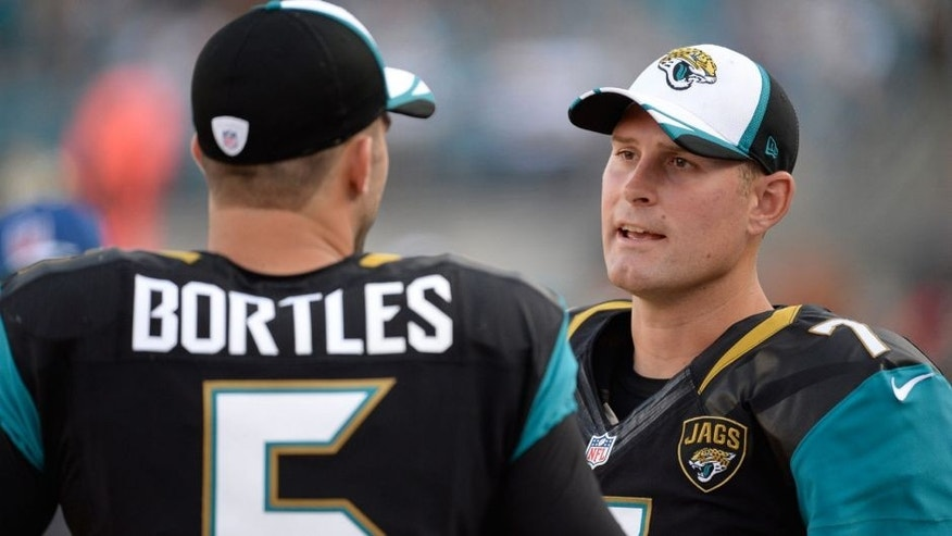 Aug 28, 2014; Jacksonville, FL, USA; Jacksonville Jaguars quarterbacks Blake Bortles (5) and Chad Henne (7) talk on the sidelines during the first half during the game against the Atlanta Falcons at EverBank Field. Mandatory Credit: Richard Dole-USA TODAY Sports