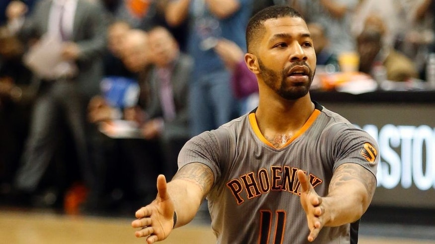 Feb 26, 2015; Phoenix, AZ, USA; Phoenix Suns forward Markieff Morris (11) reacts after scoring against the Oklahoma City Thunder during the fourth quarter at US Airways Center. Mandatory Credit: Rick Scuteri-USA TODAY Sports