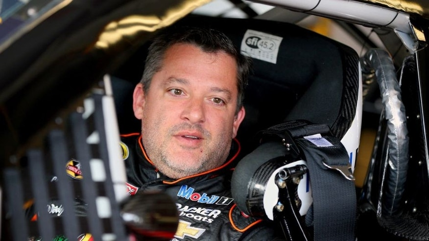 WATKINS GLEN, NY - AUGUST 07: Tony Stewart, driver of the #14 Bass Pro Shops/Mobil 1 Chevrolet, sits in his car in the garage area during practice for the NASCAR Sprint Cup Series Cheez-It 355 at Watkins Glen International on August 7, 2015 in Watkins Glen, New York. (Photo by Matt Sullivan/Getty Images)