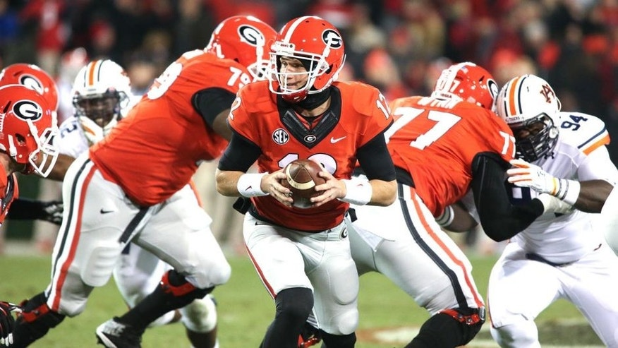 Nov 15, 2014; Athens, GA, USA; Georgia Bulldogs quarterback Brice Ramsey (12) hands the ball off to a running back in the fourth quarter of their game against the Auburn Tigers at Sanford Stadium. Georgia won 34-7. Mandatory Credit: Jason Getz-USA TODAY Sports