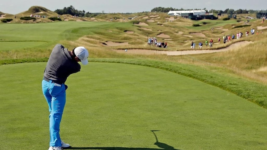 Rory McIlroy, of Northern Ireland, hits a shot on the 11th hole during a practice round for the PGA Championship golf tournament Wednesday, Aug. 12, 2015, at Whistling Straits in Haven, Wis. (AP Photo/Chris Carlson)