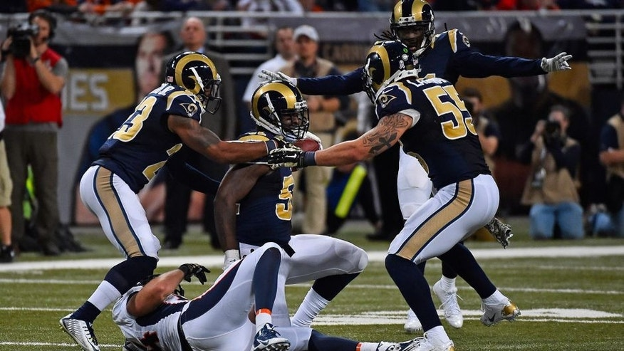 Nov 16, 2014; St. Louis, MO, USA; St. Louis Rams outside linebacker Alec Ogletree (52) reacts after intercepting a pass from Denver Broncos quarterback Peyton Manning (not pictured) during the second half at the Edward Jones Dome. The Rams won 22-7. Mandatory Credit: Jasen Vinlove-USA TODAY Sports