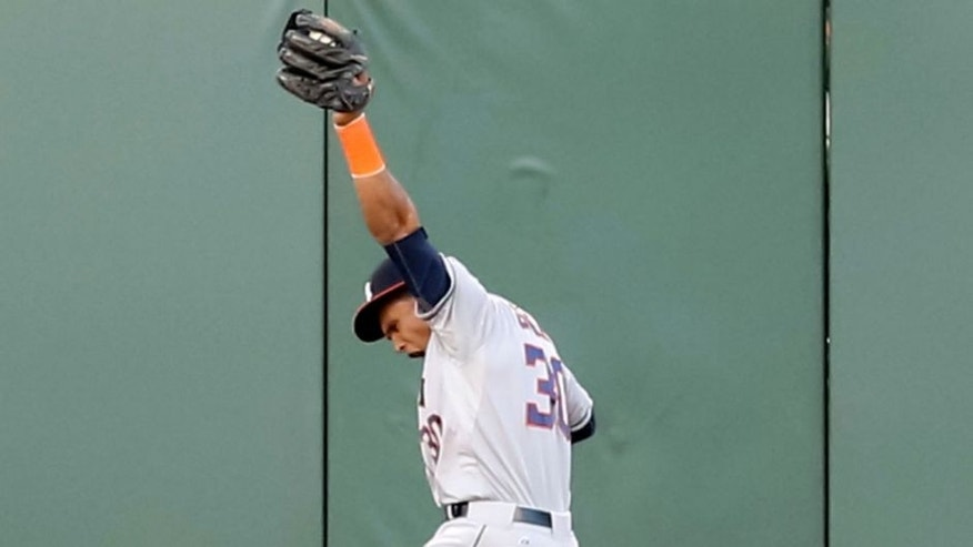 <p>Aug 11, 2015; San Francisco, CA, USA; Houston Astros center fielder Carlos Gomez (30) celebrates after catching the ball along the wall against the San Francisco Giants during the first inning at AT&T Park. Mandatory Credit: Kelley L Cox-USA TODAY Sports</p>