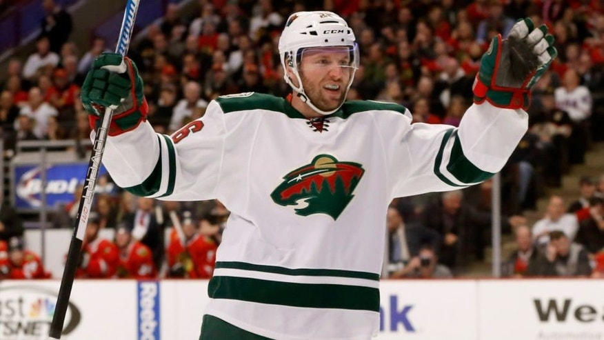 <p>Minnesota Wild left wing Thomas Vanek celebrates his goal during the first period of an NHL hockey game against the Chicago Blackhawks, Tuesday, Dec. 16, 2014, in Chicago. (AP Photo/Charles Rex Arbogast)</p>