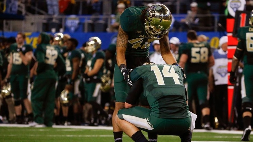 Jan 1, 2015; Arlington, TX, USA; Baylor Bears quarterback Bryce Petty (14) and wide receiver Levi Norwood (42) react during the game against the Michigan State Spartans in the 2015 Cotton Bowl Classic at AT&T Stadium. Mandatory Credit: Kevin Jairaj-USA TODAY Sports