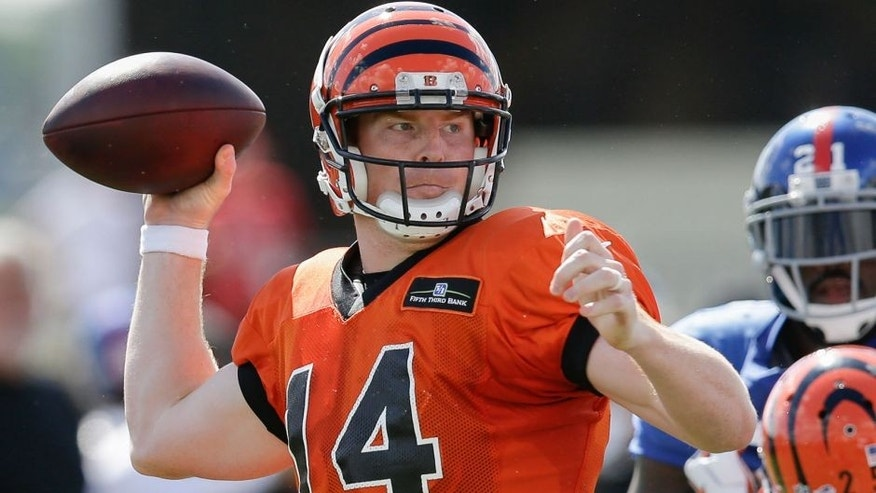Cincinnati Bengals quarterback Andy Dalton looks to throw during a joint NFL football training camp with the New York Giants, Wednesday, Aug. 12, 2015, in Cincinnati. (AP Photo/John Minchillo)