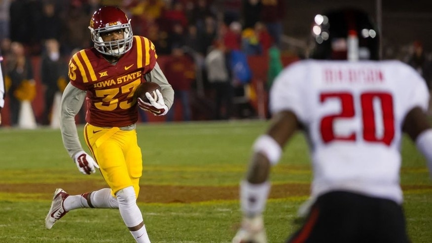 Nov 22, 2014; Ames, IA, USA; Iowa State Cyclones running back Tyler Brown (33) carries the ball against the Texas Tech Red Raiders at Jack Trice Stadium. Mandatory Credit: Steven Branscombe-USA TODAY Sports