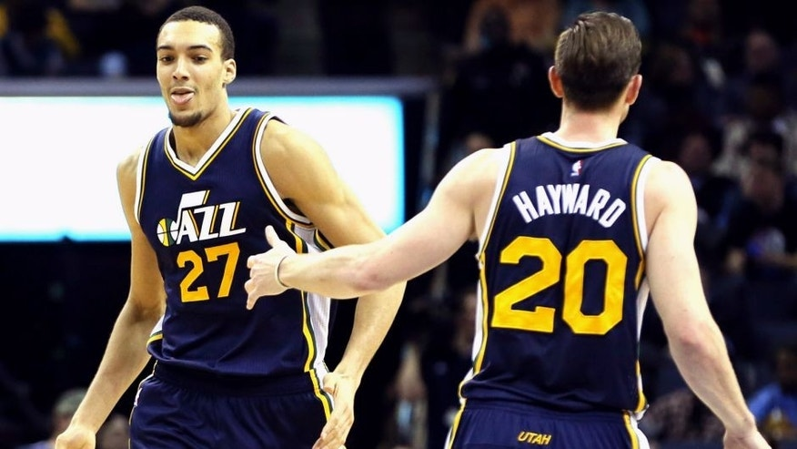 Mar 3, 2015; Memphis, TN, USA; Utah Jazz center Rudy Gobert (27) celebrates with guard Gordon Hayward (20) after a score against the Memphis Grizzlies in the second half at FedExForum. Utah defeated Memphis 93-82. Mandatory Credit: Nelson Chenault-USA TODAY Sports
