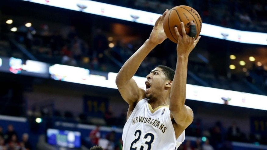 Mar 7, 2014; New Orleans, LA, USA; New Orleans Pelicans power forward Anthony Davis (23) drives past Milwaukee Bucks power forward Jeff Adrien (12) during the first quarter of a game at the Smoothie King Center. Mandatory Credit: Derick E. Hingle-USA TODAY Sports