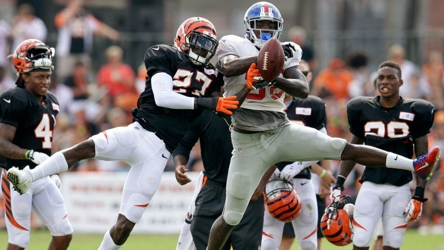Cincinnati Bengals cornerback Dre Kirkpatrick (27) blocks a pass to New York Giants wide receiver Corey Washinton during NFL football training camp, Tuesday, Aug. 11, 2015, in Cincinnati. (AP Photo/John Minchillo)