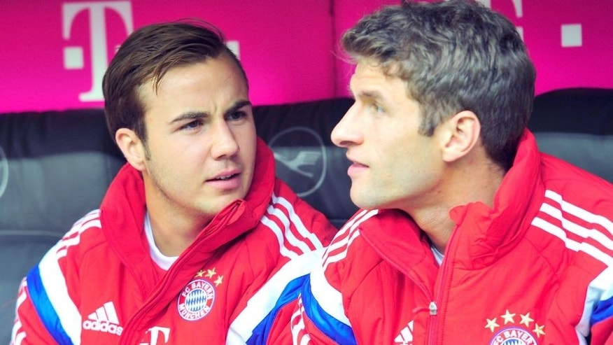 MUNICH, GERMANY - OCTOBER 04: Mario Goetze (L) and Thomas Mueller of Muenchen look on as they sit on the bench prior to the Bundesliga match between FC Bayern Muenchen and Hannover 96 at Allianz Arena on October 4, 2014 in Munich, Germany. (Photo by Lennart Preiss/Bongarts/Getty Images)