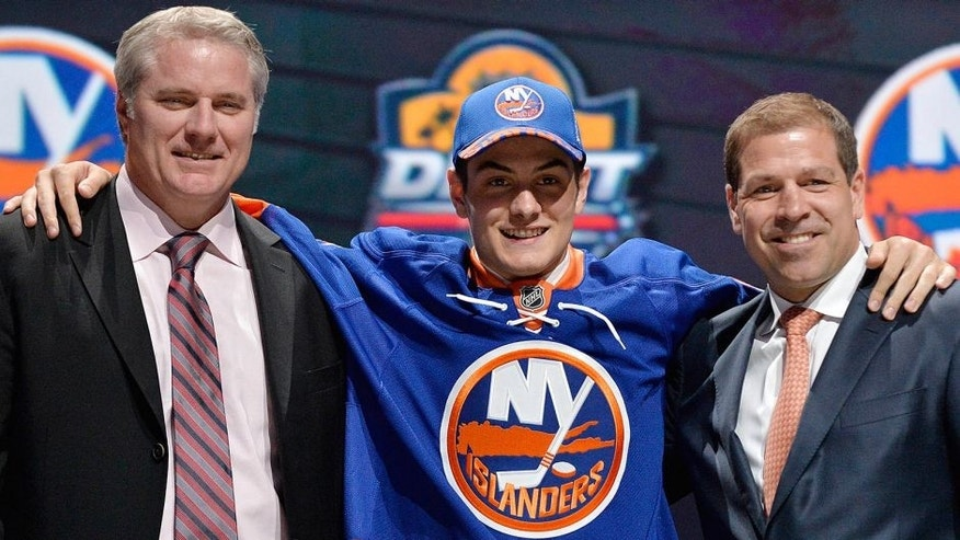 Jun 26, 2015; Sunrise, FL, USA; Mathew Barzal poses with team executives after being selected as the number sixteen overall pick to the New York Islanders in the first round of the 2015 NHL Draft at BB&T Center. Mandatory Credit: Steve Mitchell-USA TODAY Sports