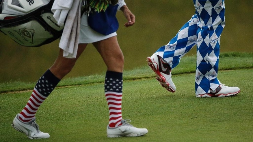 John Daly walks up the 10th hole during the first round of the PGA Championship golf tournament Thursday, Aug. 13, 2015, at Whistling Straits in Haven, Wis. (AP Photo/Jae Hong)