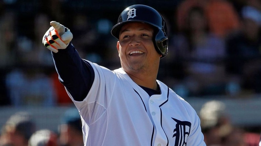 Feb 28, 2014; Lakeland, FL, USA; Detroit Tigers first baseman Miguel Cabrera (24) points and smiles while on deck to bat against the New York Yankees at Joker Marchant Stadium. Mandatory Credit: Kim Klement-USA TODAY Sports