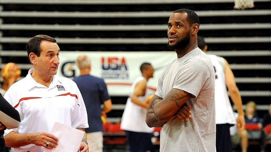 LAS VEGAS, NV - JULY 23: LeBron James (R) talks with Head Coach Mike Krzyzewski of the 2010 USA Basketball Men's National Team during training camp at Cox Pavilion on July 23, 2010 in Las Vegas, Nevada. NOTE TO USER: User expressly acknowledges and agrees that, by downloading and/or using this Photograph, user is consenting to the terms and conditions of the Getty Images License Agreement. Mandatory Copyright Notice: Copyright 2010 NBAE (Photo by Andrew D. Bernstein/NBAE via Getty Images) *** Local Caption *** LeBron James;Mike Krzyzewski