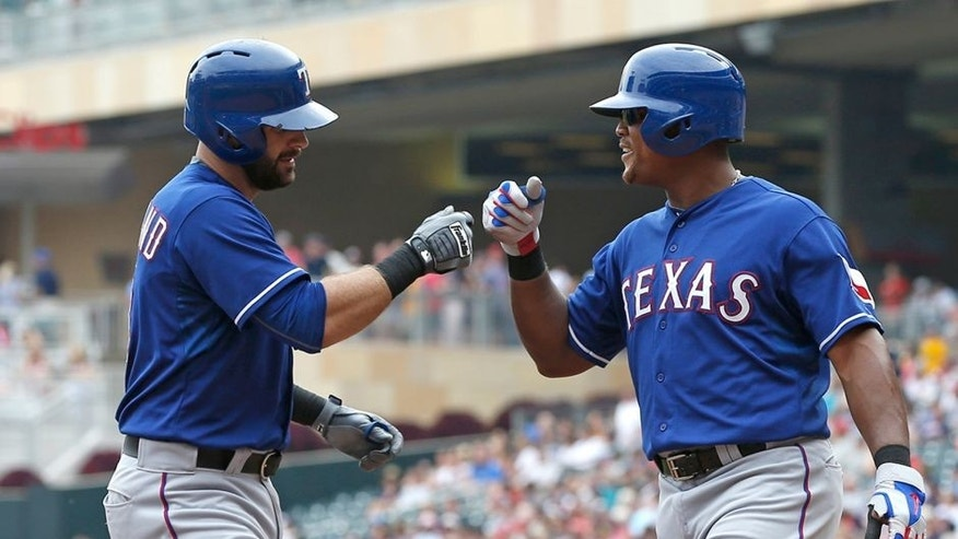 Texas Rangers' Mitch Moreland, left, is congratulated by Adrian Beltre following his two-run home run off Minnesota Twins pitcher Ervin Santana in the fourth inning of a baseball game, Thursday, Aug. 13, 2015, in Minneapolis. (AP Photo/Jim Mone)