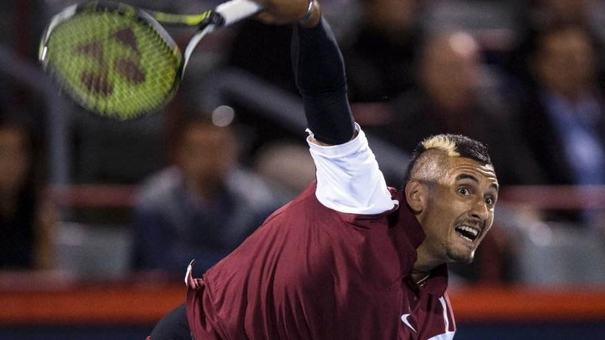 Nick Kyrgios of Australia serves to Stan Wawrinka of Switzerland during second round of play at the Rogers Cup tennis tournament Wednesday August 12, 2015 in Montreal. THE CANADIAN PRESS/Paul Chiasson at the Rogers Cup tennis tournament Wednesday, Aug. 12, 2015, in Montreal. (Paul Chiasson/The Canadian Press via AP)