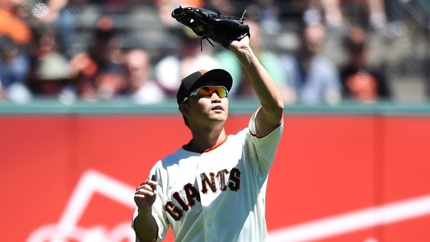 SAN FRANCISCO, CA - AUGUST 12: Nori Aoki #23 of the San Francisco Giants catches a fly ball off the bat of Preston Tucker #20 of the Houston Astros in the top of the fourth inning at AT&T Park on August 12, 2015 in San Francisco, California. (Photo by Thearon W. Henderson/Getty Images)