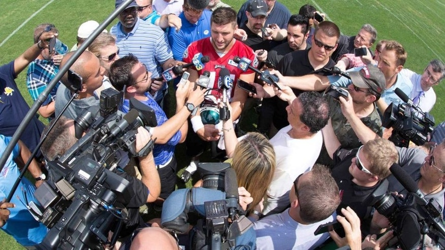 May 28, 2015; Philadelphia, PA, USA; Philadelphia Eagles quarterback Tim Tebow (11) talks to the media during OTA's at the NovaCare Complex. Mandatory Credit: Bill Streicher-USA TODAY Sports