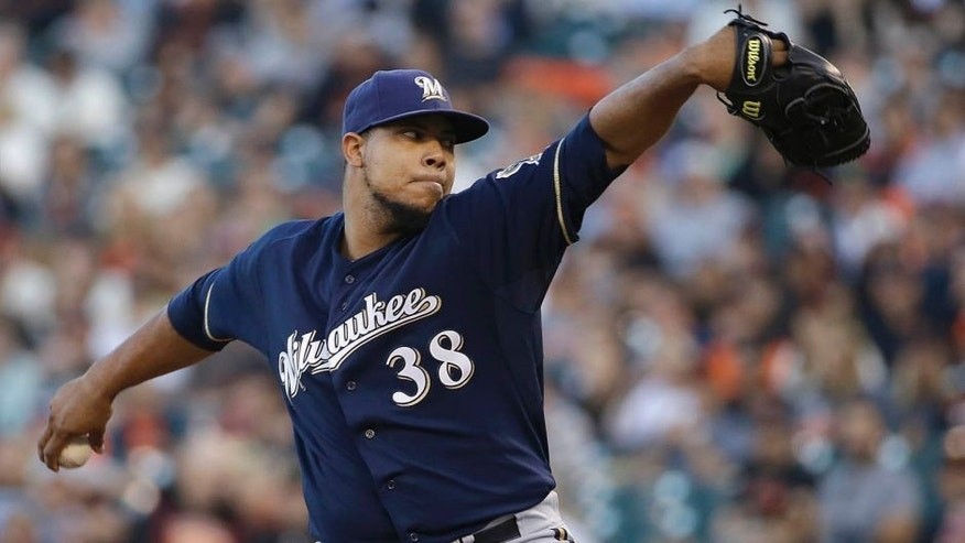 Milwaukee Brewers pitcher Wily Peralta throws against the San Francisco Giants during the first inning in San Francisco, Tuesday, July 28, 2015.
