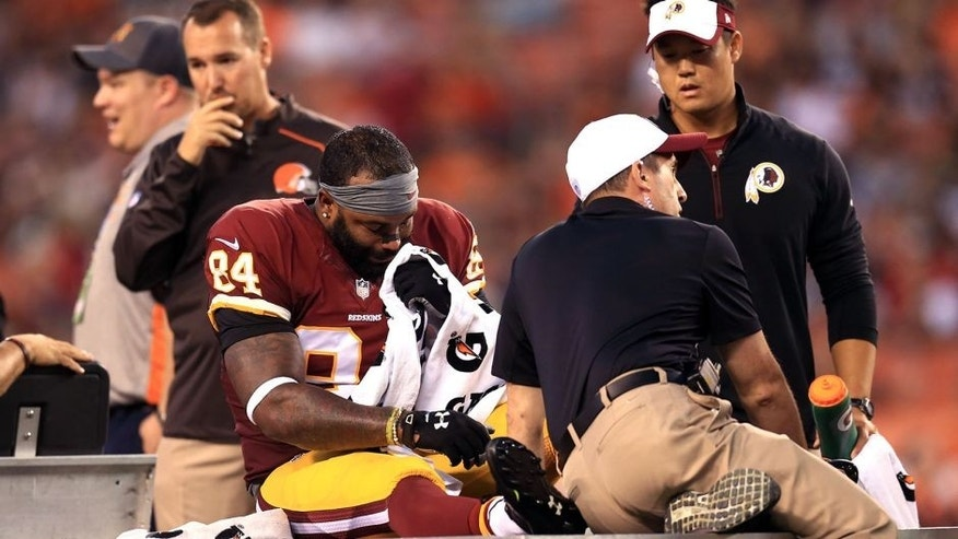 Aug 13, 2015; Cleveland, OH, USA; Washington Redskins tight end Niles Paul (84) is carted off the field after an injury during the first quarter of preseason NFL football game against the Cleveland Browns at FirstEnergy Stadium. Mandatory Credit: Andrew Weber-USA TODAY Sports
