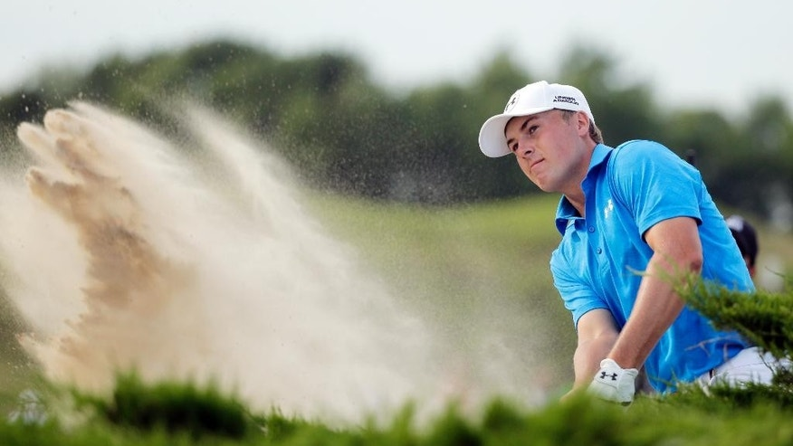 Jordan Spieth hits out of a bunker on the 15th hole during the first round of the PGA Championship golf tournament Thursday, Aug. 13, 2015, at Whistling Straits in Haven, Wis. (AP Photo/Jae Hong)