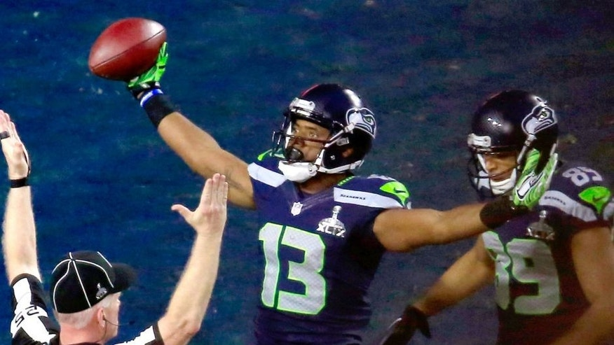 Chris Matthews #13 of the Seattle Seahawks celebrates scoring an 11 yard touchdown late in the second quarter with Doug Baldwin #89 against the New England Patriots during Super Bowl XLIX at University of Phoenix Stadium on February 1, 2015 in Glendale, Arizona. (Photo by Jamie Squire/Getty Images)
